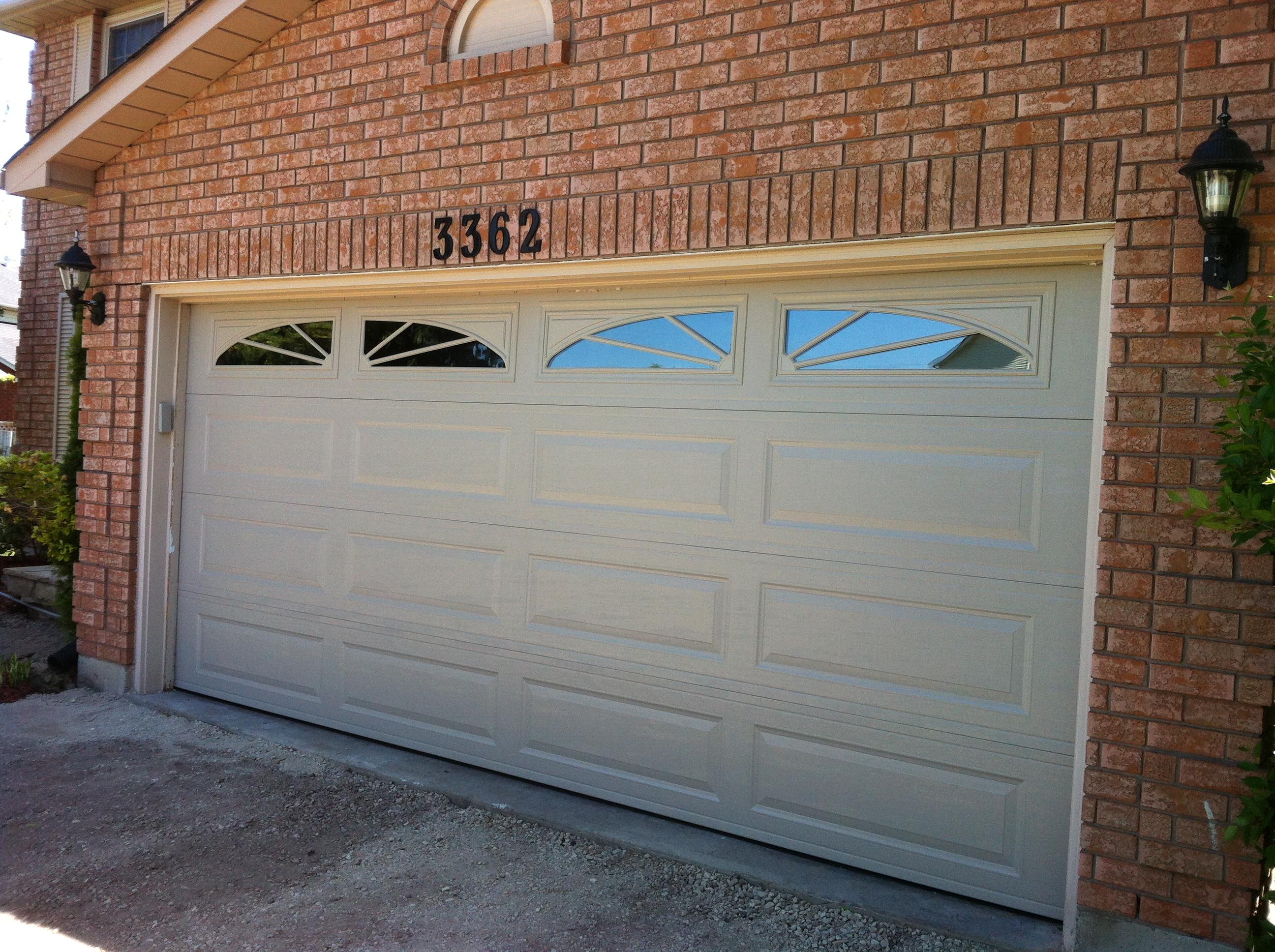 doors on traditional arch amarr door garage exterior steel pinterest l design striking